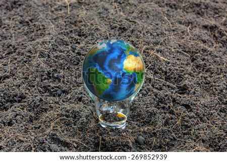 Earth in light bulb (Elements of this image furnished by NASA) - stock photo