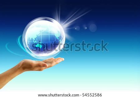 earth in palm of a human hand - stock photo