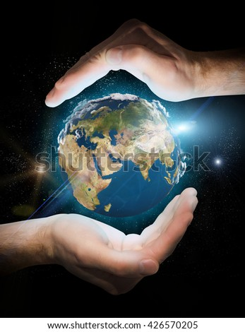earth in space. planet in the hands