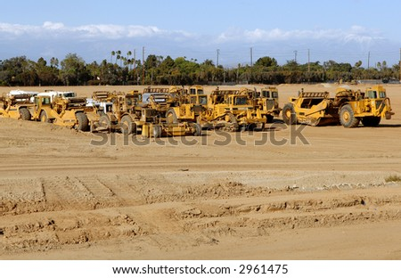 Earth Moving Equipment Parked After A Day of Work - stock photo