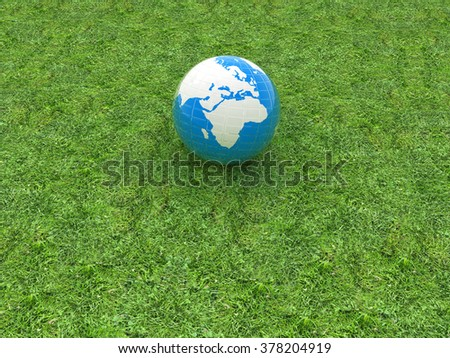 earth on a green grass - stock photo
