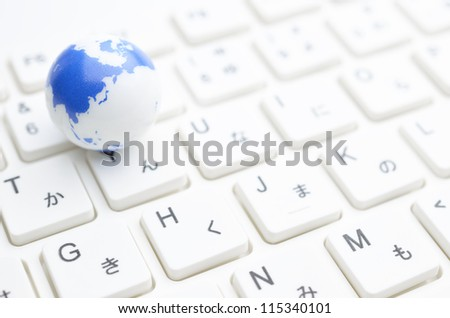 earth on keyboard - stock photo