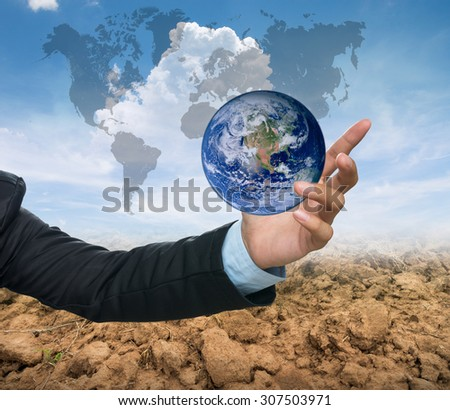 earth over the Business hands on dry rice filed and blue sky with cloud background. environment concept. Elements of this image furnished by NASA. green world concept