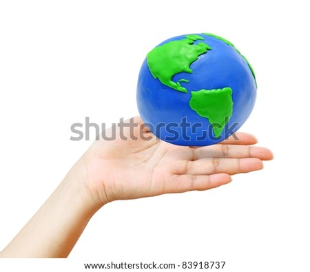 earth over the young hand isolated on white background