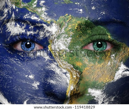 Earth painted on face. Elements of this image furnished by NASA - stock photo