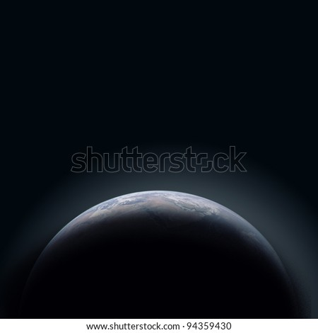 Earth Planet in dark and cold space - stock photo