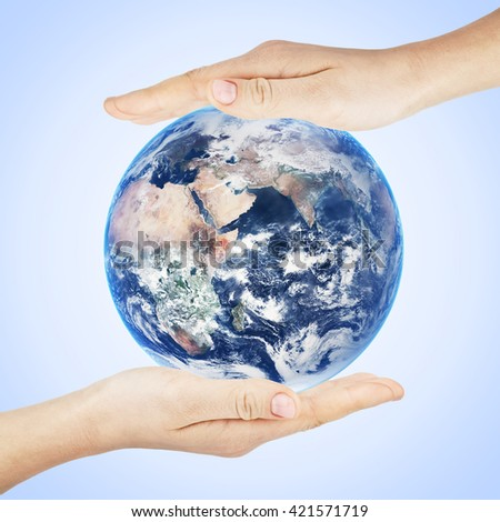Earth planet in hand. Elements of this image furnished by NASA - stock photo