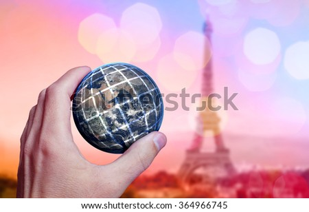 Earth planet in male hand. London city background. Elements of this image furnished by NASA