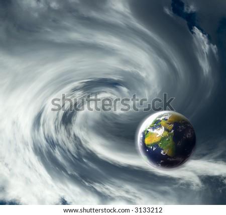 earth planet on the edge of big twirl - stock photo