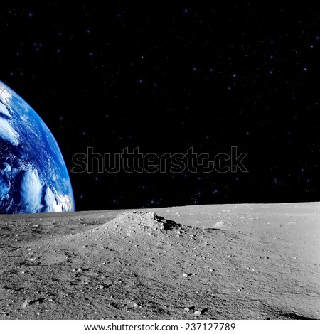 Earth-rise and stars as seen from the lunar surface. Elements of this image furnished by NASA. - stock photo