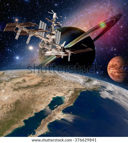 Earth satellite astronomy international space station iss saturn planet mars. Elements of this image furnished by NASA. - stock photo