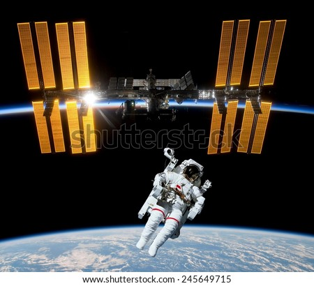 Earth satellite space station spaceship astronaut spaceman. Elements of this image furnished by NASA. - stock photo