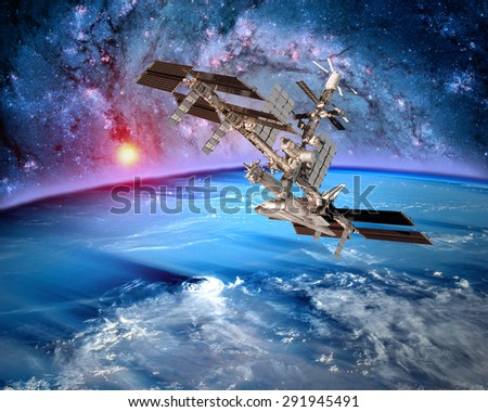 Earth satellite space station spaceship orbit fantasy landscape. Elements of this image furnished by NASA. - stock photo