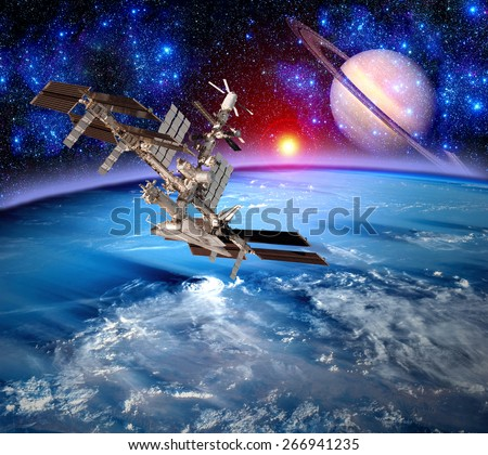 Earth space station spaceship world alien landscape saturn planet. Elements of this image furnished by NASA. - stock photo