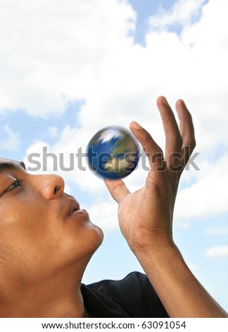 earth spinning in your hand - stock photo