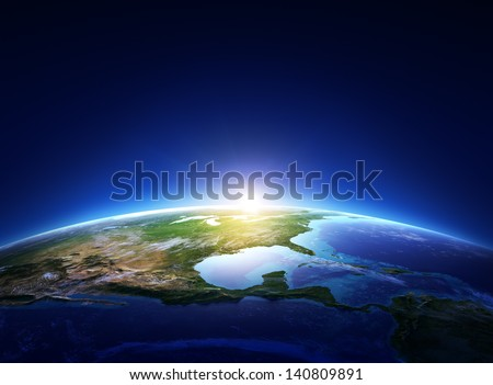 Earth sunrise North America with light clouds  (Elements of this image furnished by NASA) - stock photo