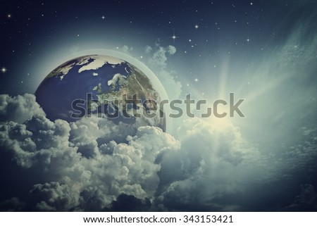 Earth view in the cloudy skies. NASA imagery used - stock photo