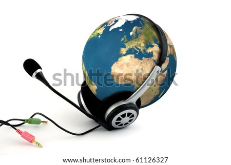 Earth with headphones - communication concept - stock photo