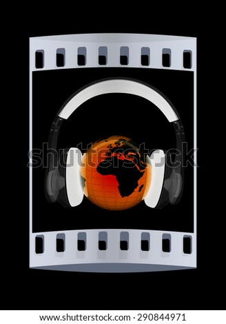 earth with headphones from transparent plastic. World music concept isolated on black. The film strip - stock photo