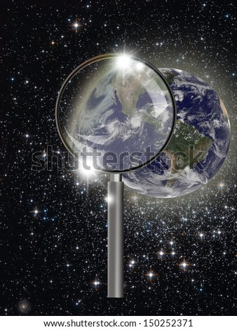 """Earth with magnifying glass """"Elements of this image furnished by NASA""""  - stock photo"""