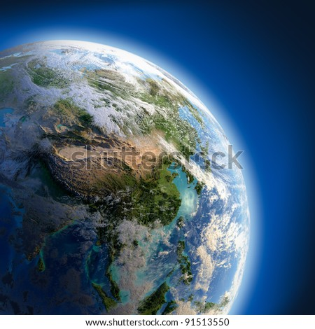 Earth with relief, high detailed surface, translucent ocean and atmosphere, illuminated by sunlight - stock photo