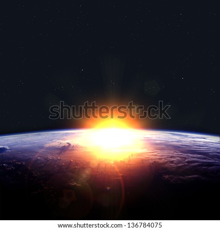 Earth with rising sun. Elements of this image furnished by NASA - stock photo