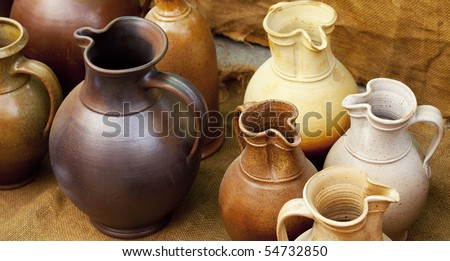 earthenware jars standing on linen rag - stock photo
