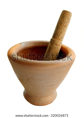 Earthenware mortar and wooden pestle isolated on white background