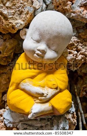 Earthenware of child monk - stock photo
