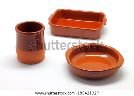 Earthenware tableware isolated on white background - stock photo