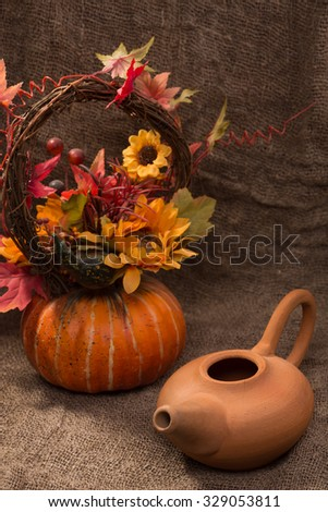 earthenware teapot with a decorative pumpkin