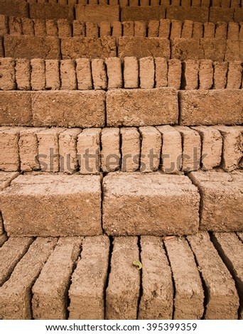 Earthern bricks close up background. - stock photo
