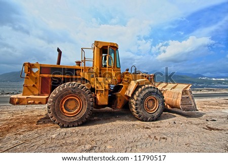 earthmover working on construction site - stock photo