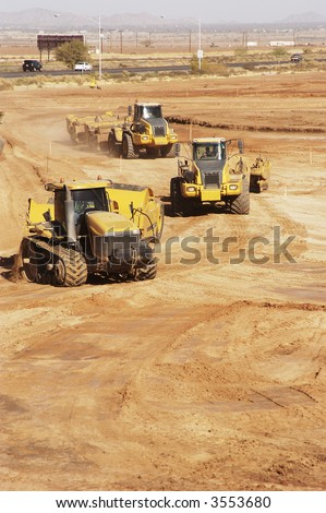 earthmoving equipment at work preparing a construction site for development.