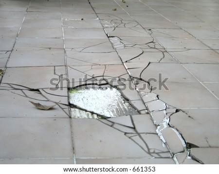 earthquake crack on a building floor. Showing the devastation of the quake wave. - stock photo