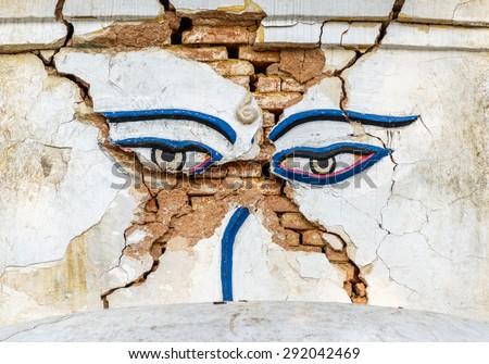 Earthquake damaged Buddha's eyes at Swayambhunath in Kathmandu, Nepal - stock photo