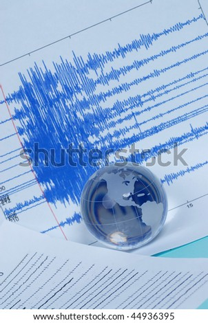earthquake seismograph and earth globe - stock photo