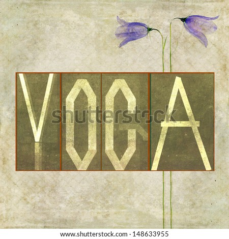 """Earthy background image and design element depicting the word """"Yoga"""" - stock photo"""