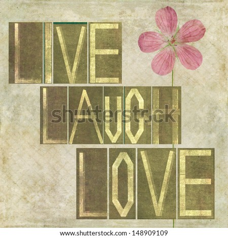 """Earthy background image and design element depicting the words """"Live laugh love"""" - stock photo"""