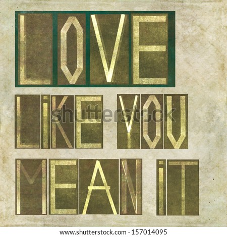 """Earthy background image and design element depicting the words """"Love like you mean it"""" - stock photo"""