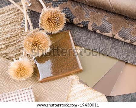 Earthy brownish interior design plan - handcrafted ceramic tile, fabric and paint color swatches - stock photo