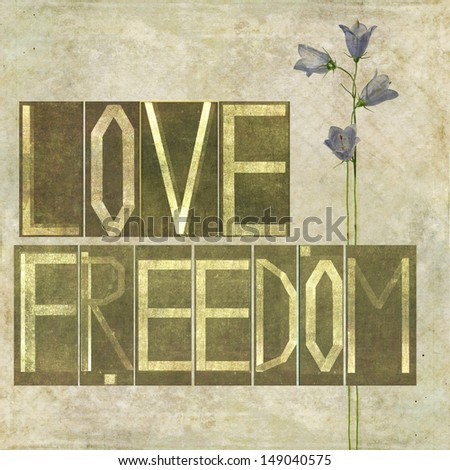 """Earthy textured background image and design element depicting the words """"Love Freedom"""" - stock photo"""