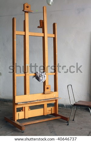 Easel in paint studio - stock photo