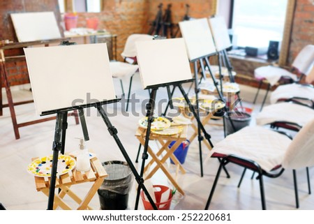 Easel in the studio  - stock photo