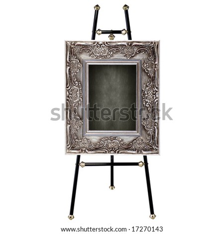 Easel with antique frame isolated on white - stock photo