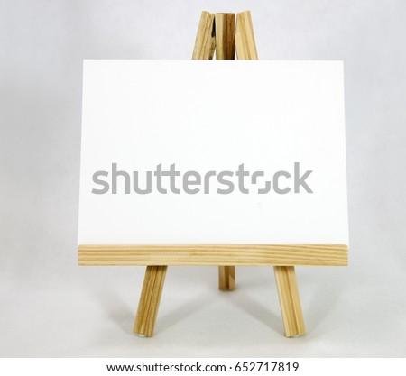 Easel with blank white card. Copy space.