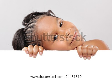 Easily expandable copy space being held by a cute little girl - stock photo