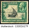 EAST AFRICAN POSTAL UNION - CIRCA 1935: A stamp printed in East African postal Union (Kenya, Uganda, Tanganyika) shows portrait of King George V and a dhow on lake Victoria, circa 1935 - stock photo