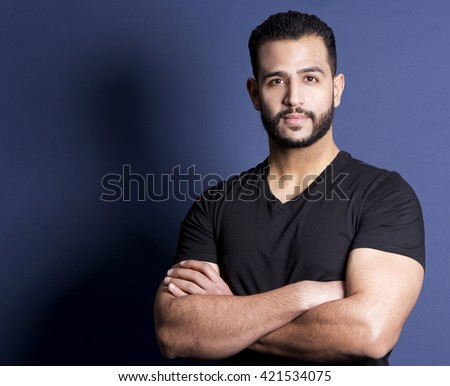 east asian handsome man wearing black tshirt and jeans  - stock photo