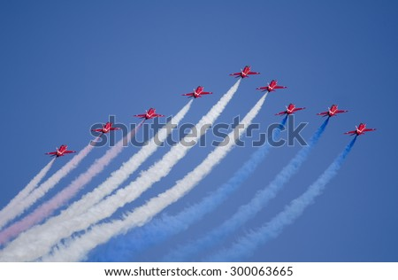 EAST FORTUNE, UNITED KINGDOM - JULY 25: the RAF Red Arrows flight display team on July 25, 2015 above East Fortune, United Kingdom. 2015 marks the 50th year of Red Arrows flight displays. - stock photo